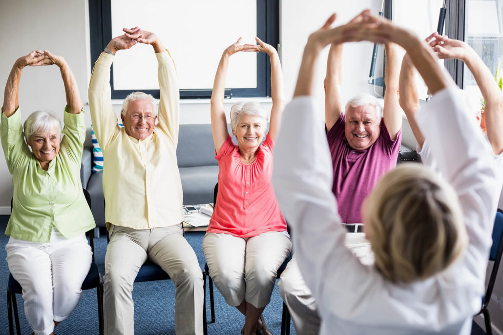 older men and women exercising at the Towncenter assisted living community fitness facility